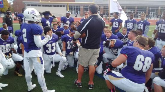 Coach Rich Holzer congratulates the team after the Homecoming win over MIAA rival Loyola.