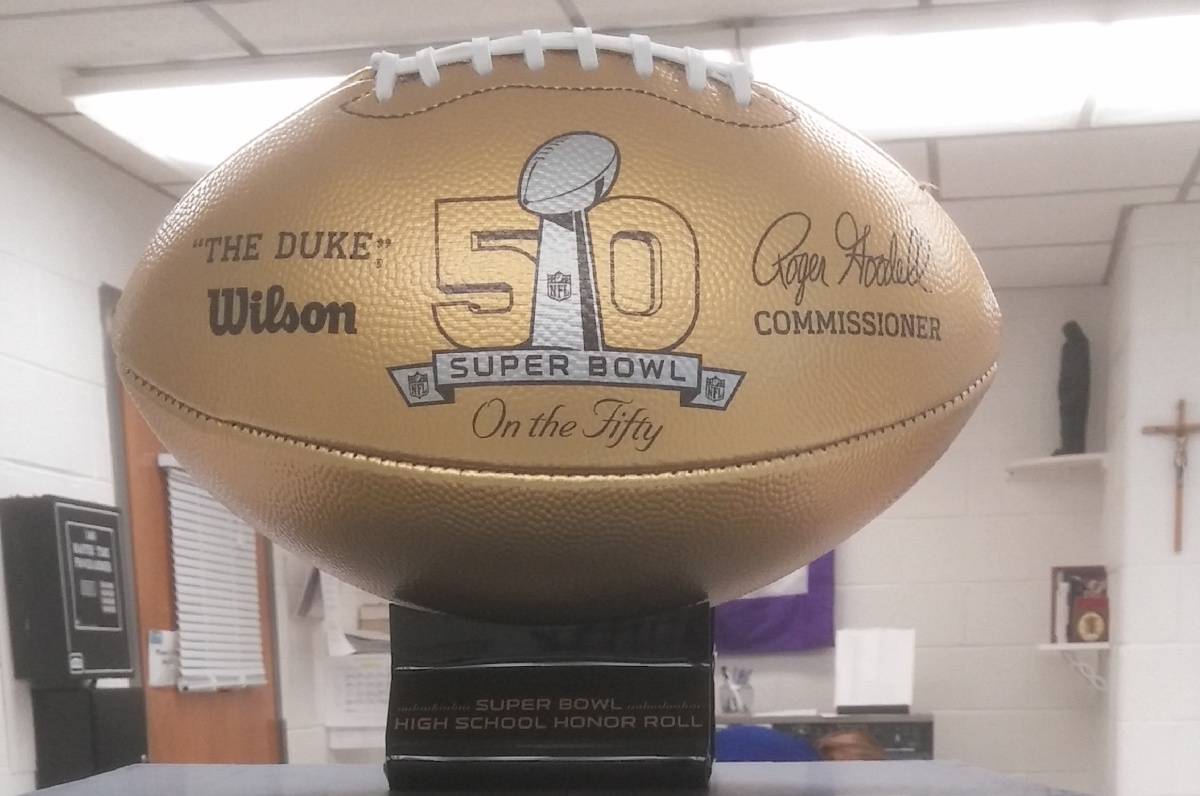 Mount Saint Joseph Receives Golden Ball from the Super Bowl Honor Roll